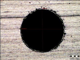 Microscopic image of the hole Ø0.9 mm, magnification 100x